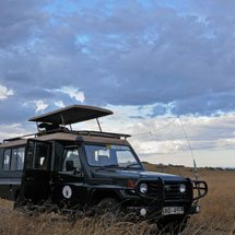 Four wheel drive car of Sunworld safari at sunset in Masai Mara, Kenya, Africa